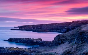 Sea cliffs in Stonehaven, pink sunset